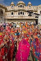 Rajasthani women dressed in their finest dance at the GANGUR FESTIVAL also known as the MEWAR FESTIVAL - UDAIPUR, RAJASTHAN, INDIA