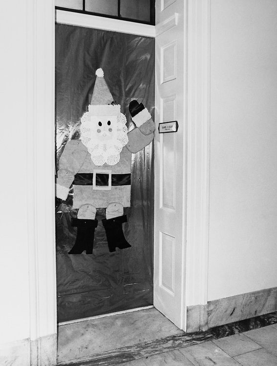 Rep. Daniel J. Flood, D-Pa., decorated office door with Santa Claus around Christmas. (Photo by Dev O'Neill/CQ Roll Call via Getty Images)