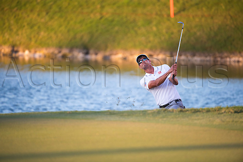 06.03.2016. Doral, Florida, USA. Adam Scott of Australia chips at the 18th hole during the final round of the World Golf Championships-Cadillac Championship on the TPC Blue Monster course at the Trump Doral Golf Club and Resort in Doral, FL.