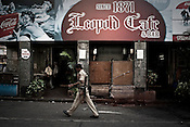 A security force personnel walks past the the Leopold Cafe, one of the sites of the 2008 terrorist attacks in Mumbai, India. Photograph: Sanjit Das