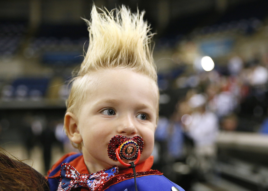 19-month-old Curtis Ray Jeffery II, of Louisiana, wears a pacifier with U.S. presidential candidate Donald Trump's image on it before a rally in Baton Rouge, Louisiana February 11, 2016. REUTERS/Jonathan Bachman