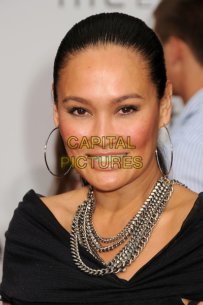 """TIA CARRERE.""""Prince Of Persia: The Sands Of Time"""" Los Angeles Premiere held at Grauman's Chinese Theatre, Hollywood, California, USA..May 17th, 2010.headshot portrait black chains hoop gold earrings silver necklaces .CAP/ADM/BP.©Byron Purvis/AdMedia/Capital Pictures."""