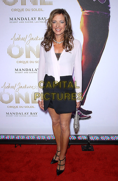 Allison Janney<br /> &quot;Michael Jackson One&quot; world premiere at Mandalay Bay Resort and Casino, Las Vegas, NV, USA, 29th April 2013.<br /> full length white shirt jacket black skirt dress <br /> CAP/ADM/MJT<br /> &copy; MJT/AdMedia/Capital Pictures