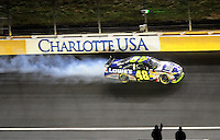 Oct. 17, 2009; Concord, NC, USA; NASCAR Sprint Cup Series driver Jimmie Johnson (48) celebrates after winning the NASCAR Banking 500 at Lowes Motor Speedway. Mandatory Credit: Mark J. Rebilas-