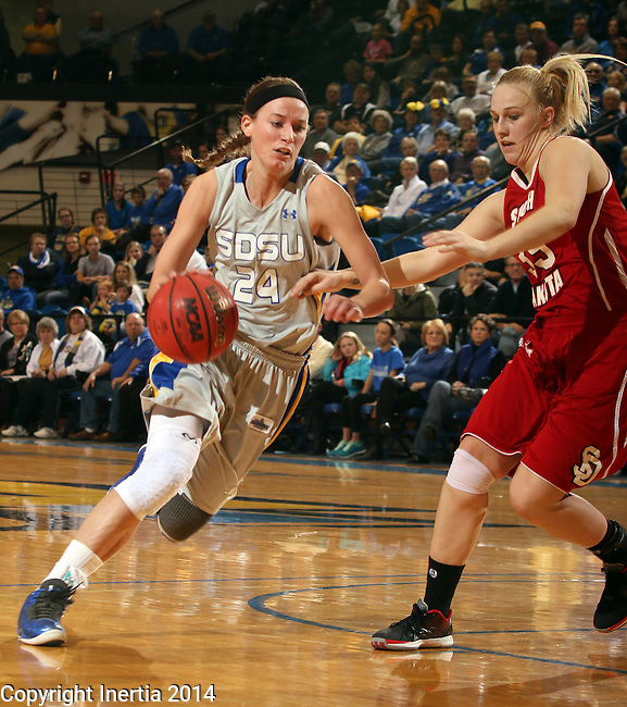 BROOKINGS, SD - FEBRUARY 2:  Megan Waytashek #24 from South Dakota State drives against Nicole Seekamp #35 from the University of South Dakota in the first half of their game Sunday afternoon at Frost Arena in Brookings. (Photo by Dave Eggen/Inertia)