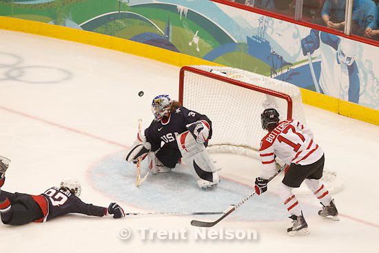 Trent Nelson  |  The Salt Lake Tribune.USA's Jessie Vetter deflects a shot. USA vs. Canada, gold medal game, women's Ice Hockey at the Canada Hockey Place, Vancouver, XXI Olympic Winter Games, Thursday, February 25, 2010.