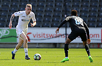 SWANSEA, WALES - MARCH 25:Oli McBurnie of Swansea City is closely marked by Musa Yahaya of Porto during the Premier League International Cup Semi Final match between Swansea City and Porto at The Liberty Stadium on March 25, 2017 in Swansea, Wales. (Photo by Athena Pictures)