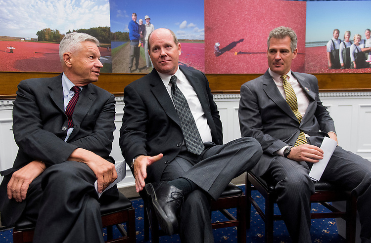 UNITED STATES - JUNE 6: From left, Rep. Thomas Petri, R-Wisc., Rep. Reid Ribble, R-Wisc., and Sen. Scott Brown, R-Mass., talk during the event to announce the formation of the Congressional Cranberry Caucus in the Rayburn House Office Building on Wednesday , June 6, 2012. (Photo By Bill Clark/CQ Roll Call)
