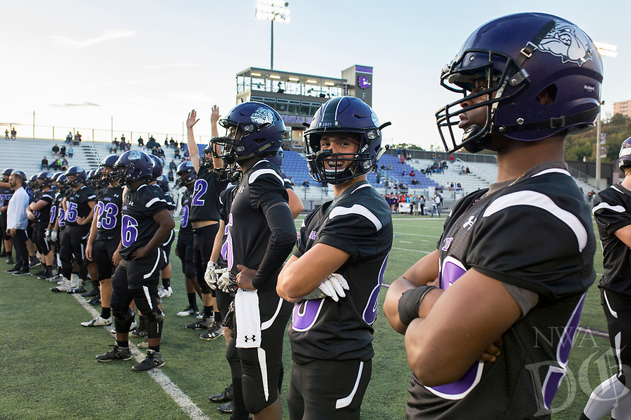 NWA Democrat-Gazette/CHARLIE KAIJO Fayetteville High School football players warm up ahead of the first half of the football game on Friday, October 20, 2017 at Fayetteville High School in Fayetteville.