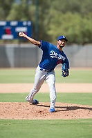 Los Angeles Dodgers relief pitcher Aldry Acosta (21) delivers a pitch during an Instructional League game against the Milwaukee Brewers at Maryvale Baseball Park on September 24, 2018 in Phoenix, Arizona. (Zachary Lucy/Four Seam Images)