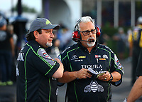 Apr 21, 2017; Baytown, TX, USA; Tommy DeLago (right) crew chief for NHRA funny car driver Alexis DeJoria (not pictured) and Nick Boninfante  during qualifying for the Springnationals at Royal Purple Raceway. Mandatory Credit: Mark J. Rebilas-USA TODAY Sports