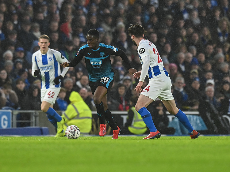 West Bromwich Albion's Jonathan Leko (left) under pressure from Brighton & Hove Albion's Davy Propper (left) <br /> <br /> Photographer David Horton/CameraSport<br /> <br /> Emirates FA Cup Fourth Round - Brighton and Hove Albion v West Bromwich Albion - Saturday 26th January 2019 - The Amex Stadium - Brighton<br />  <br /> World Copyright © 2019 CameraSport. All rights reserved. 43 Linden Ave. Countesthorpe. Leicester. England. LE8 5PG - Tel: +44 (0) 116 277 4147 - admin@camerasport.com - www.camerasport.com