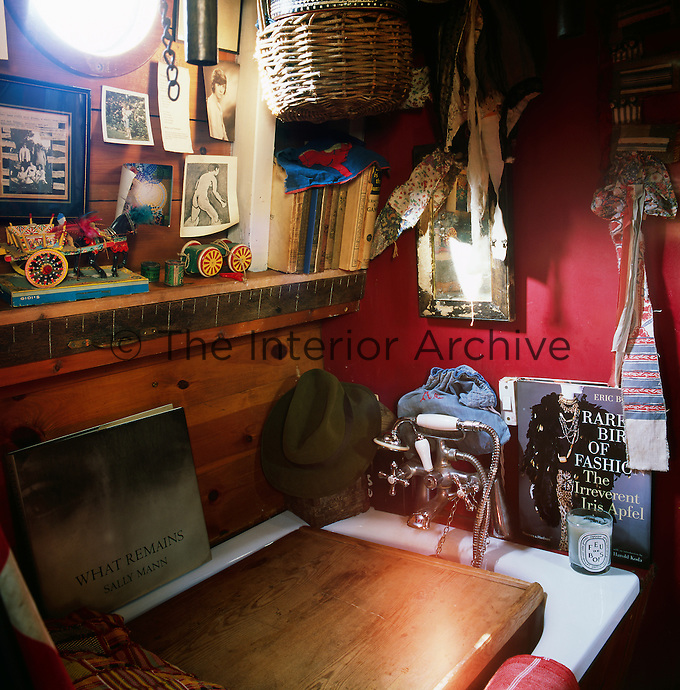 The cosy interior of a canal boat decorated in a bohemian style. A corner of the bathroom area