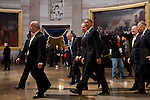 President Barack Obama and Vice President Joe Biden walk through the US Capitol Rotunda after they were sworn-in for a second term during the presidential inauguration, January 21, 2013.