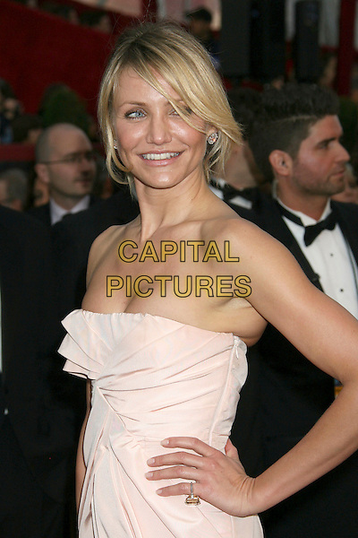 CAMERON DIAZ.The 80th Annual Academy Awards Arrivals held at the Kodak Theatre, Hollywood, California, USA..February 24th, 2008.half length strapless dress white cream gathered hand on hip ring pink oscars.CAP/ADM/RE.©Russ Elliot/AdMedia/Capital Pictures.