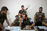 32 year old Hajji Mari (AKA Abdul Qadr Saleh) the military commander of the Free Syrian Army's Unity Brigade that took Aleppo is seen with some of his soldiers whilst talking to media in Aleppo.