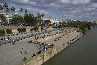 People next Gudalquivir River in Sevilla