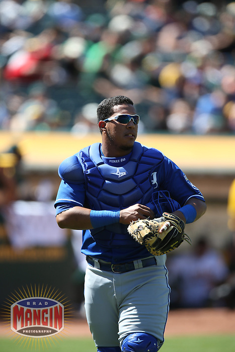 OAKLAND, CA - MAY 19:  Salvador Perez #13 of the Kansas City Royals works behind the plate during the game against the Oakland Athletics at O.co Coliseum on Sunday May 19, 2013 in Oakland, California. Photo by Brad Mangin
