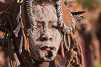 Mursi woman portrait  with her lip deformed to dress a typical plate in Omo valley Ethiopia