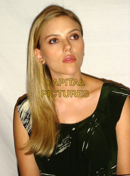 "SCARLETT JOHANSSON.Photocall for ""Vicky Cristina Barcelona"", the Four Seasons, Los Angeles, California, USA..August 4th, 2008.headshot portrait black green sleeveless .CAP/AW.©Anita Weber/Capital Pictures."