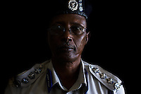 """Gen Abdi Hassan Awaked, Somali Transitional Federal Government police commissioner in his office In  Somalia's war torn capital Mogadishu on Tuesday April 22nd 2008.///...Sporadic street fighting between Ethiopian .troops and Islamic fighters trying to bring down Somalia's shaky .government has killed 81 people on April 19 and 20, the head of a .local human rights group said Sunday. .""""The casualties ... were caused by Ethiopians using heavy artillery and .tank shells in residential areas of the war-torn capital. We condemn .this latest fighting,"""" said Sudan Ali Ahmed, chairman of Elman Human .Rights. Besides the 81 dead, 119 people had been wounded, he said. .Reports on Monday April 21 say Ethiopian troops have taken control of a mosque with a large .number of civilians inside following heavy fighting with insurgents. .The reports say a number of civilians were killed inside the mosque and others are being held by Ethiopians against .their will. .This apparent increase in the brutality of attacks may be caused partly by a .recent American decision to classify the Shabab (youth), the Islamic Courts .Union's former military wing, as a terrorist group. Battered by Ethiopian attacks .and by infighting between sub-clans engaged in the insurgency, Shabab .fighters now probably number fewer than 400. But America's decision to .demonise them has boosted jihadist commanders such as Aden Hashi Ayro, .strengthening his reputation for piety and anti-Americanism, which has itself .been boosted by recent missile attacks that have accidentally killed civilians...Philippe Lazzarini, head of the UN Office for the Coordination of Humanitarian Affai .rs (OCHA) Somalia, said on Monday April 21st that the combination of a severe drought, civil insecurity and h .yperinflation was pushing the country to the brink. If the situation were happening a .nywhere else """"it would have triggered outrage"""". .Lazzarini said Somalia was """"on the eve of a massive, massive humanitarian catast .rophe"""", wit"""