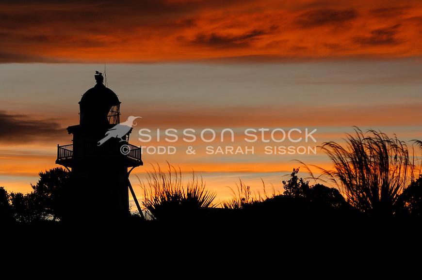 Katiki Point Lighthouse in silhouette at sunset,  near Moeraki Villiage, Coastal Otago, South Island, New Zealand - stock photo, canvas, fine art print
