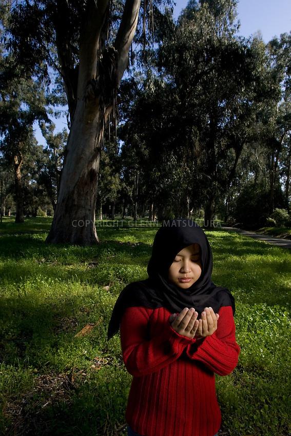Stanford student, Atiqah Zailani (Muslim) among trees near Palm Drive.