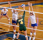 BROOKINGS, SD - SEPTEMBER 30:  Brianna Rasmusson #4 from North Dakota State looks to get a kill between Wagner Larson #11 and Kacey Herrmann #3 from South Dakota State in the second game of their match Tuesday night at Frost Arena in Brookings. (Photo/Dave Eggen/Inertia)