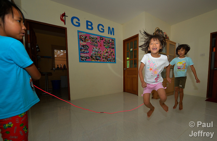 Girls jump rope in an orphanage founded by United Methodist missionaries in Chiang Mai, Thailandi. The girls are orphans, and are all HIV positive.