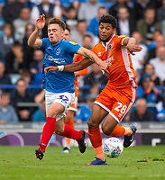 Portsmouth's Ben Thompson (left) vies for possession with Shrewsbury Town's Josh Laurent (right) <br /> <br /> Photographer David Horton/CameraSport<br /> <br /> The EFL Sky Bet League One - Portsmouth v Shrewsbury Town - Saturday September 8th 2018 - Fratton Park - Portsmouth<br /> <br /> World Copyright &copy; 2018 CameraSport. All rights reserved. 43 Linden Ave. Countesthorpe. Leicester. England. LE8 5PG - Tel: +44 (0) 116 277 4147 - admin@camerasport.com - www.camerasport.com