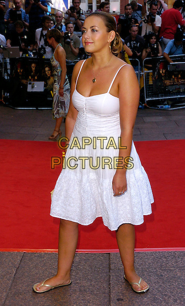 "CHARLOTTE CHURCH.The ""Pirates of the Caribbean: Dead Man's Chest"" European premiere, Odeon Leicester Square, London, UK..July 3rd, 2006.Ref: CAN.full length white dress flip flops straw bag purse.www.capitalpictures.com.sales@capitalpictures.com.©Capital Pictures"