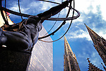 The famous Atlas Statue at Rockefeller Center with the steeples of St. Patrick's Cathedral in the background. Manhattan, New York City