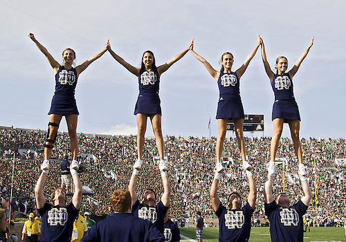 August 31, 2013:  Notre Dame cheerleaders perform during NCAA Football game action between the Notre Dame Fighting Irish and the Temple Owls at Notre Dame Stadium in South Bend, Indiana.  Notre Dame defeated Temple 28-6.