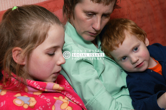 Single parent listening to her daughter reading a bedtime story,