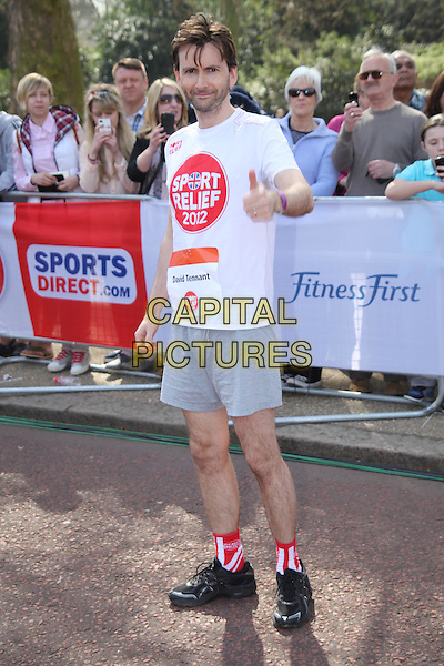 David Tennant.Sport Relief takes part in London, England..March 25th 2012.full length white t-shirt hands thumbs up grey gray shorts .CAP/JEZ  .©Jez/Capital Pictures.