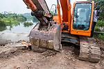 Excavator in urban wetland, Diyasaru Park, Colombo, Sri Lanka