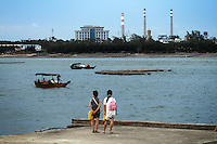 Coastal developments for industry have contributed to the disappearance of magroves in Zhanjiang, Guangdong Province. Over the past century, the world has lost over 50% of its coastal mangroves. They have been cleared mainly to make way for commercial shrimp and fish farms. The unique trees which live in salt water are valued for the ability to protect shorelines and are home to a diverse array of flora and fauna. 2010