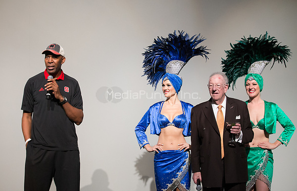 LAS VEGAS, NV - March 16, 2017: ***HOUSE COVERAGE*** Former NBA Player Thurl Bailey and Former Las Vegas Mayor and Host Committee Chairman Oscar B. Goodman pictured with showgirls at Hoops Central Basketball viewing event at Westgate Las Vegas Resort & Casino in Las vegas, NV on March 16, 2017. Credit: Erik Kabik Photography/ MediaPunch