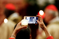 A woman uses her smartphone to take pictures during the Easter vigil ceremony celebrated by Pope Francis in St. Peter's Basilica at the Vatican, April 20, 2019.<br /> UPDATE IMAGES PRESS/Riccardo De Luca<br /> <br /> STRICTLY ONLY FOR EDITORIAL USE
