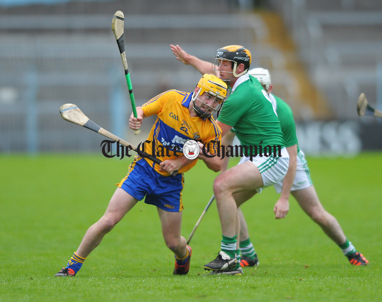 Colm Galvin of Clare in action against Tom Condon and James Ryan of Limerick during their game at Semple Stadium. Photograph by John Kelly.