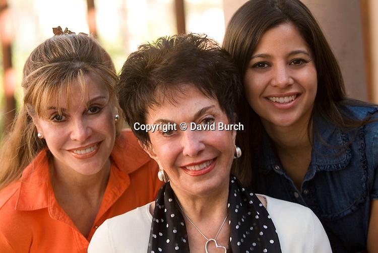 Grandmother, daughter and grand daughter smiling