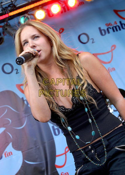 LUCIE SILVAS.Performs live in concert at 96.4 BRMB's Party In The Park, Cannon Hill Park, Birmingham, .July 3rd 2005..half length gig Lucy black camisole vest top turquiose beads necklace.Ref: JEZ.www.capitalpictures.com.sales@capitalpictures.com.©Jez Self/Capital Pictures