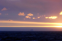 Sun set on the berg - At sea off the Adelie Land, Antarctica