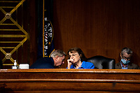 """United States Senator Lindsey Graham (Republican of South  Carolina), Chairman, US Senate Judiciary Committee, left, confers with US Senator Dianne Feinstein (Democrat of California), Ranking Member, US Senate Judiciary Committee, right, during a US Senate Judiciary Committee Hearing """"to examine COVID-19 fraud, focusing on law enforcement's response to those exploiting the pandemic"""" on Capitol Hill in Washington, DC on June 9, 2020. <br /> Credit: Erin Schaff / Pool via CNP/AdMedia"""