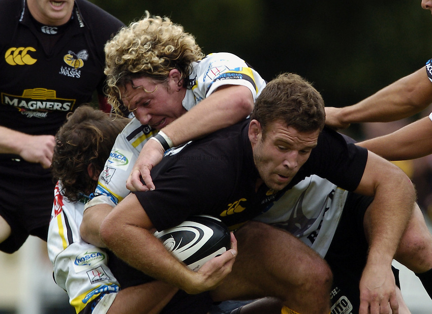 Photo: Jonathan Butler..London Wasps v Calvisano. Pre Season Friendly. 20/08/2006..Joe Worsley of London Wasps is pinned down by two defenders.