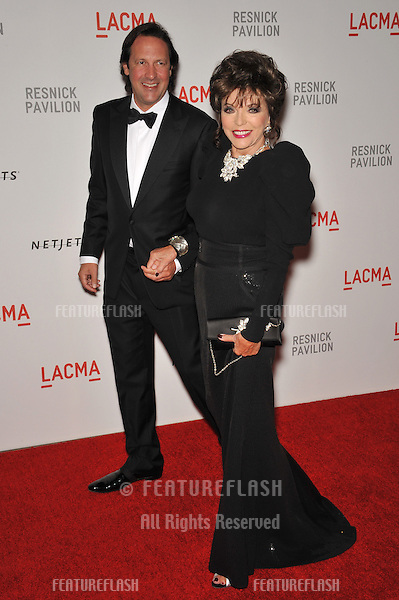 "Joan Collins & Percy Gibson at a benefit gala at the Los Angeles County Museum of Art (LACMA) to celebrate the official ""unmasking"" of the museum's newest building, The Lynda and Stewart Resnick Exhibition Pavilion..September 25, 2010  Los Angeles, CA.Picture: Paul Smith / Featureflash"