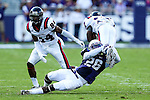 Samford Bulldogs running back Krondis Larry (17)  and TCU Horned Frogs safety Derrick Kindred (26) in action during the game between the Samford Bulldogs and the TCU Horned Frogs at the Amon G. Carter Stadium in Fort Worth, Texas.  TCU leads Stamford 24 to 7 at halftime.