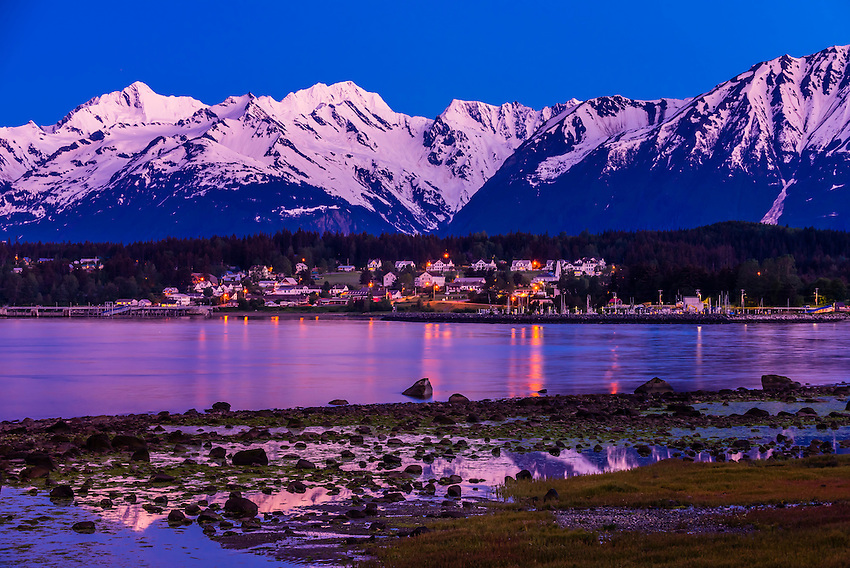 Haines, Alaska USA. Haines is surrounded by mountains and water. Rising high above the town are the Takinsha Mountains and Chilkat Range to the south, Takshanuk Mountains to the north and Coast Mountains to the east across the Lynn Canal.
