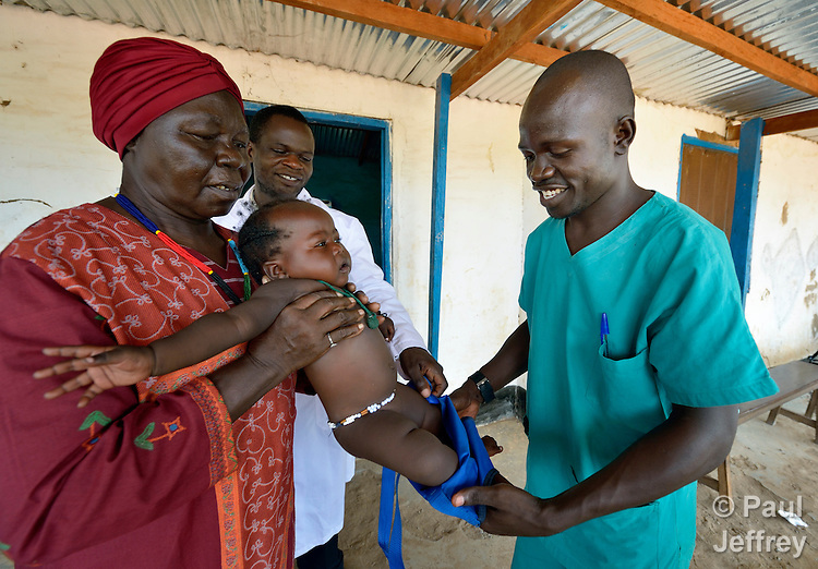 Kennedy Michael prepares a child to be weighed in a clinic in Wau, South Sudan, as nurse Margaret Kubri assists him. Michael is a student nurse from the Catholic Health Training Institute in Wau. Health care is minimal in the newly independent country, and many religious groups are providing personnel and training to fill the gap. The Institute is coordinated by Solidarity with South Sudan, an international consortium of more than 200 religious congregations that trains teachers, health workers and pastoral personnel in several locations throughout South Sudan..