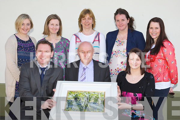 Knockanes NS Principal Danny Doherty with the staff of Knockanes NS, Glenflesk and the painting by Mark Eldred (Silver Birch and Bluebells in Muckross) that was presented on his retirement at the school on Tuesday seated l-r: Paul Horan, Danny Doherty, Mairead Doherty. Back row: Laura O'Callaghan, Marie Cronin, Linda Logan, Triona Sheehy and Aideen O'Doherty......